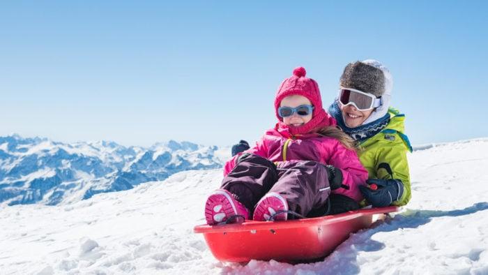 bambini che si divertono con il minibob di san rocco a Livigno